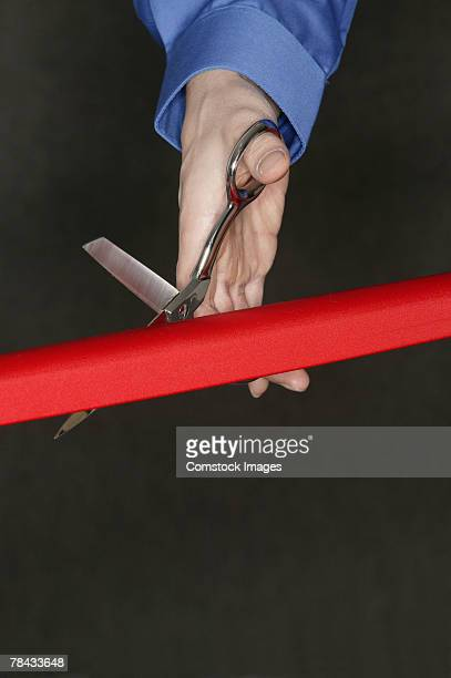 hand cutting red tape - ribbon cutting stock pictures, royalty-free photos & images