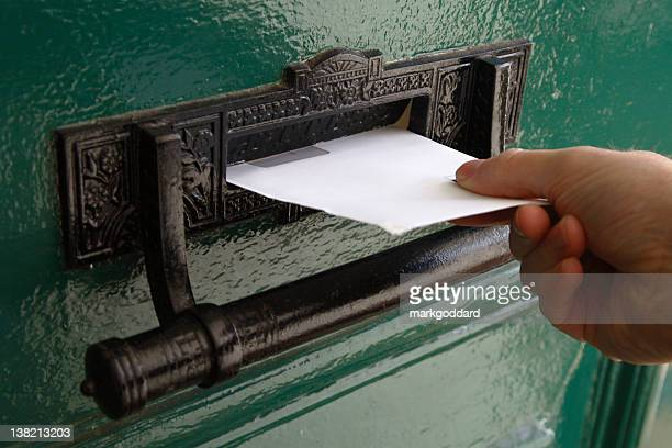 hand delivery - junk mail stock pictures, royalty-free photos & images