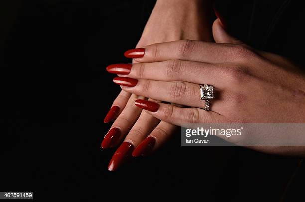 Hand detail of a model backstage ahead of the Lena Hoschek show during MercedesBenz Fashion Week Autumn/Winter 2014/15 at Brandenburg Gate on January...