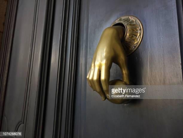 hand door knocker - door knocker stock photos and pictures