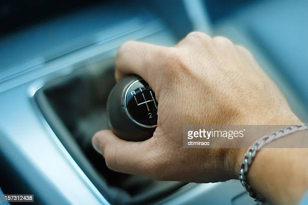 hand downshifting car five speed manual transmission - gearshift stock photos and pictures
