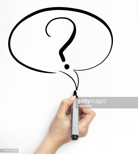 hand drawing on white page with marker a question mark in a speech bubble - q and a stock pictures, royalty-free photos & images