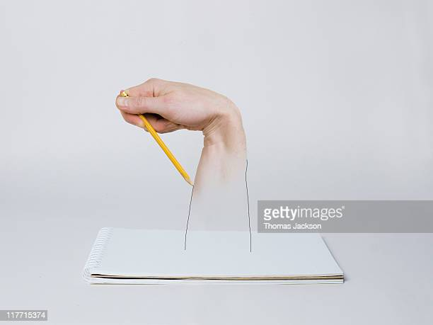 Hand drawing self with pencil