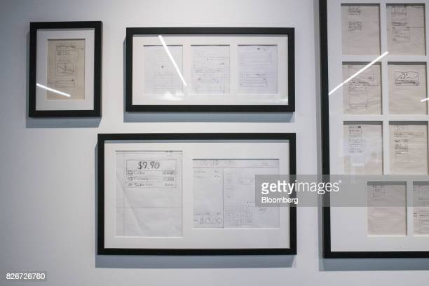 Hand drawn mock ups of the Square Inc website hang on display inside the company's headquarters in San Francisco California US on Wednesday Aug 2...