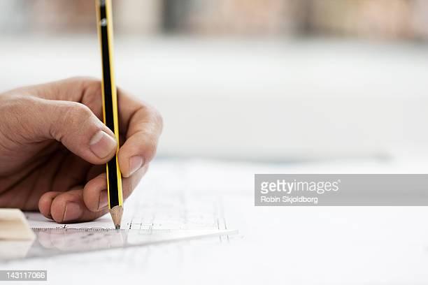 Hand draws a sketch in architect studio