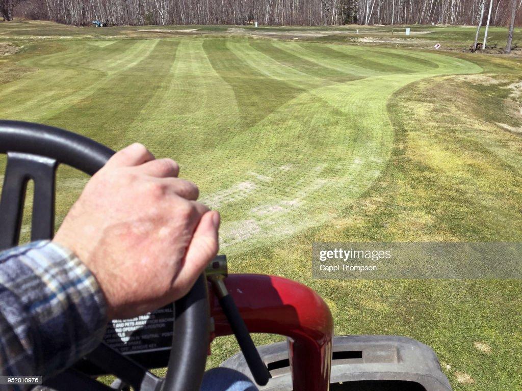Hand Driving Golf Course Triplex Greens Mower On Golf Course