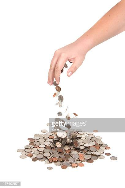 hand dropping coins - us coin stock pictures, royalty-free photos & images