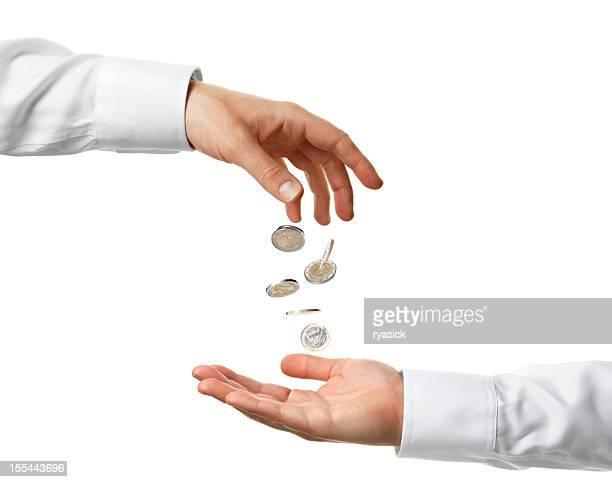 mano caída de monedas en euro en una mano recieving estirados - camisa con botones fotografías e imágenes de stock