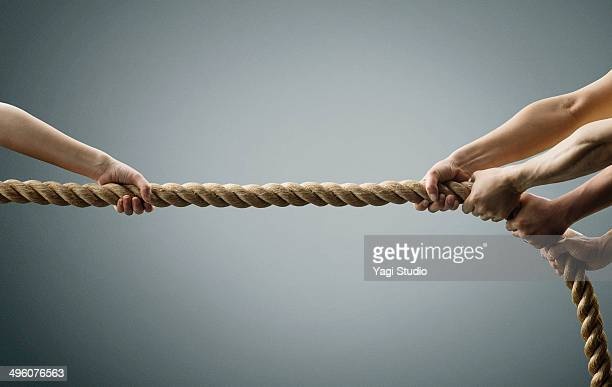 Hand each other pull the rope