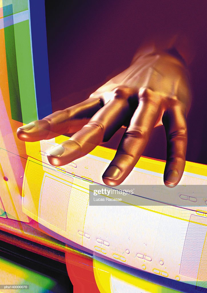 Hand emerging from computer monitor, digital composite. : Stockfoto