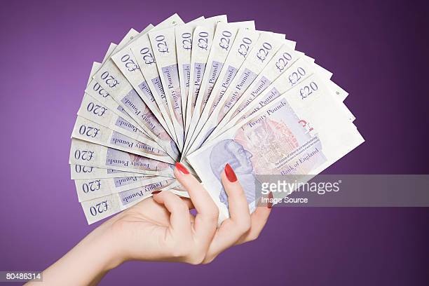 hand fan of banknotes - british pound sterling note stock pictures, royalty-free photos & images