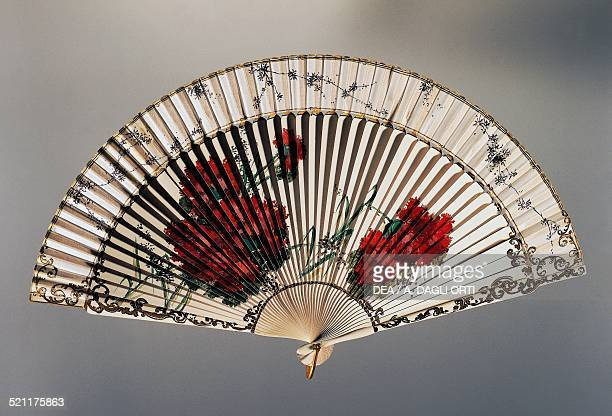 Hand fan with carnations painted organza and wooden ribs ca 1900 Spain 19th20th century Trieste Civico Museo Sartorio Spain