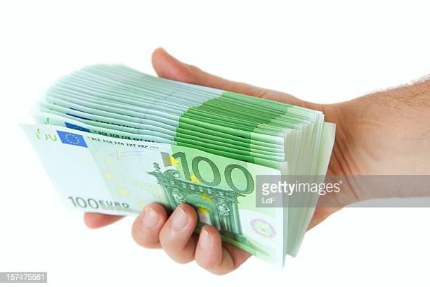 Hand full of one hunders euro bills