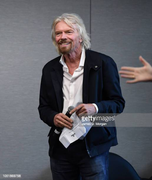 A hand gestures to introduce Sir Richard Branson during the launch of The B Team Australasia on October 11 2018 in Sydney Australia The B Team...