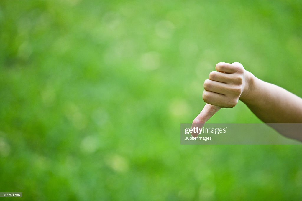 Hand gesturing thumbs-down : Stock Photo