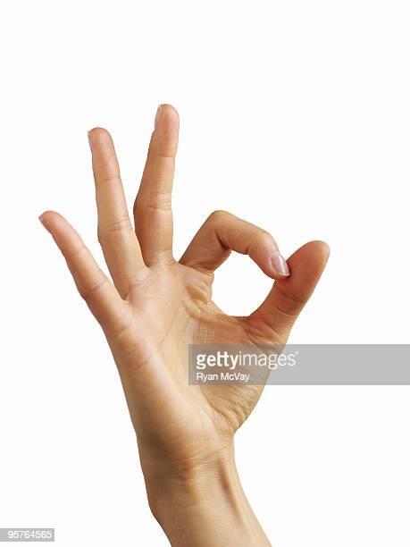 hand giving 'OK' symbol
