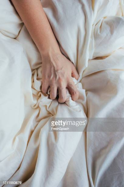 hand grabbing a bed sheet - gripping stock pictures, royalty-free photos & images
