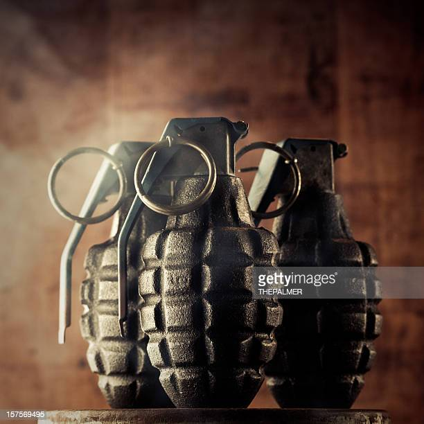 hand granades surrounded by smoke - hand grenade stock pictures, royalty-free photos & images