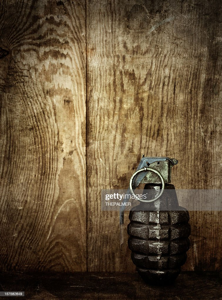 hand grenade on wooden background : Stock Photo