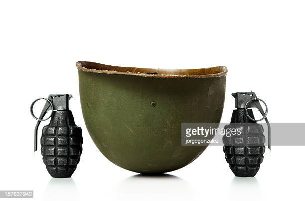 Hand grenades and army helmet