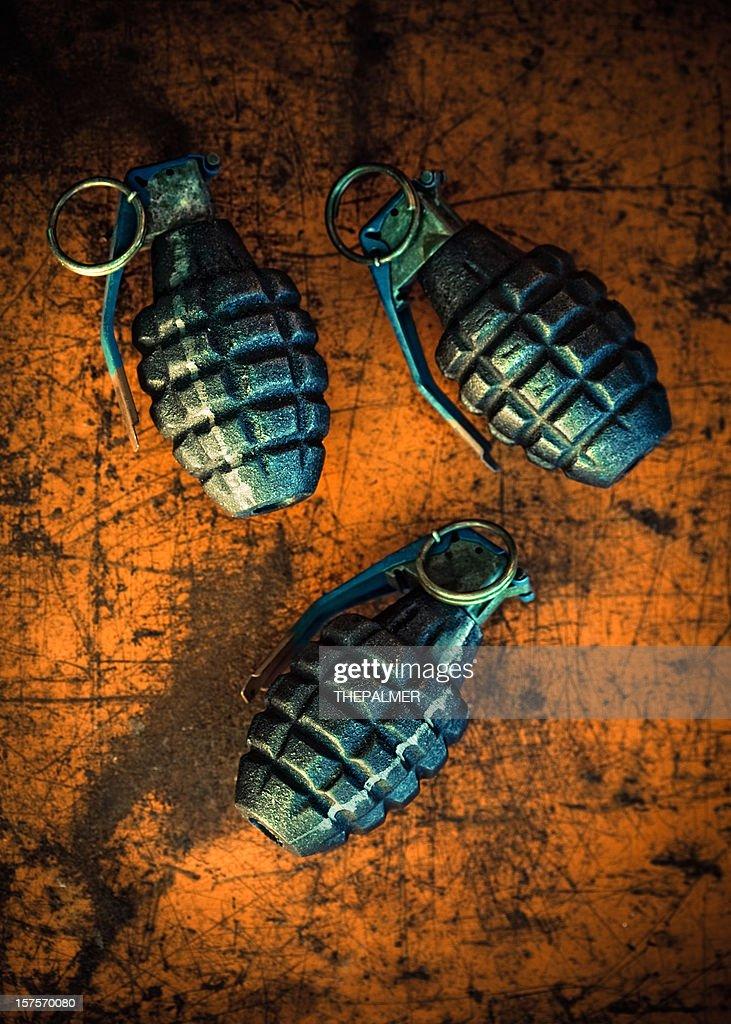 hand grenades on orange background : Stock Photo