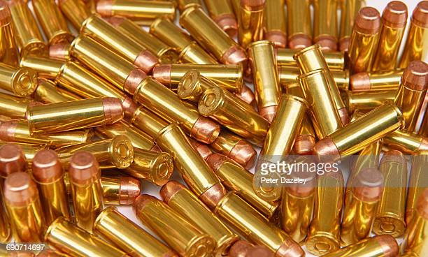 hand gun bullets 9mm - gun control stock pictures, royalty-free photos & images