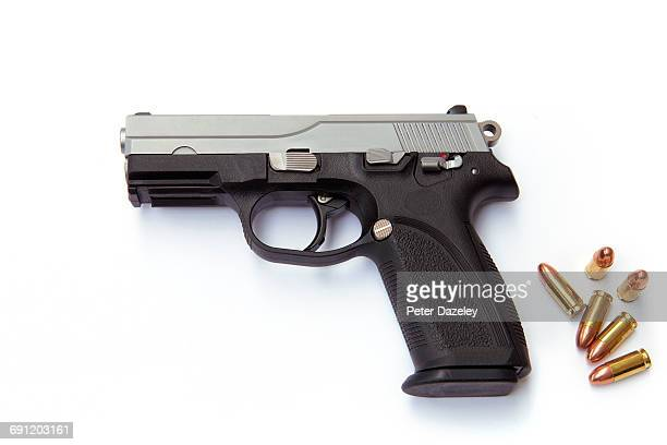 hand gun with rounds - bullet stock photos and pictures