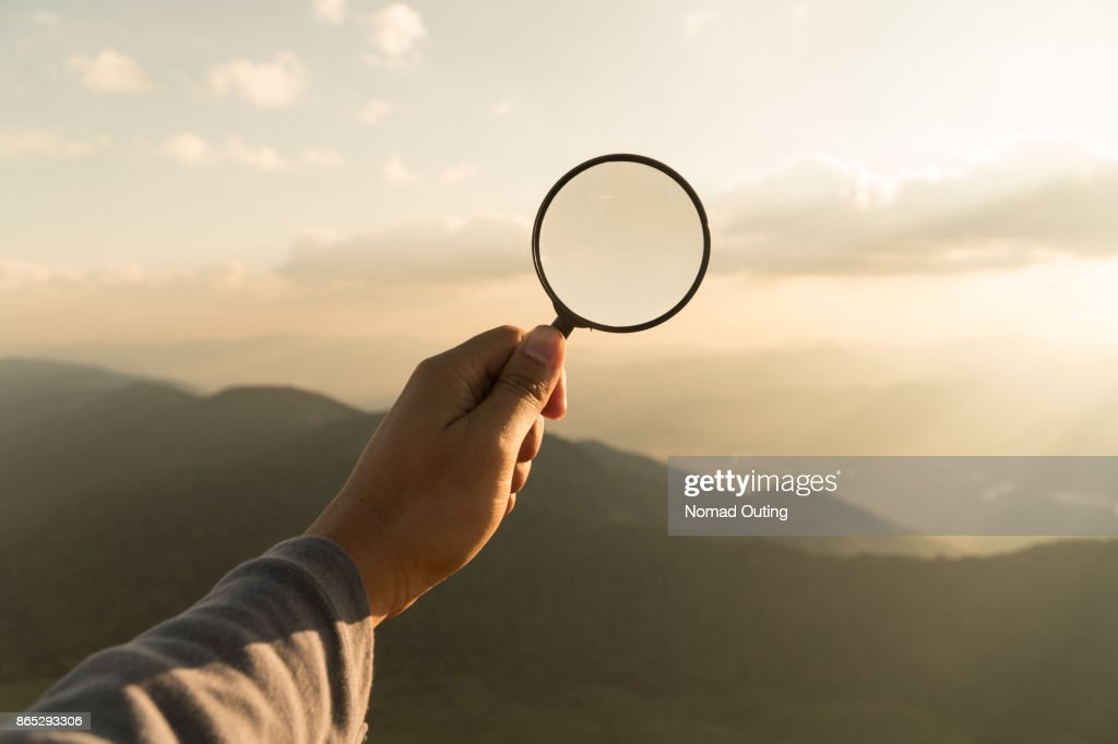 Hand hold magnifying glass : Stock Photo