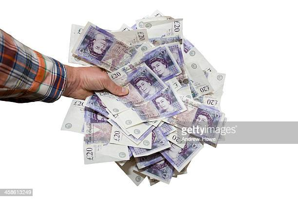 hand holding £20 notes - pound sterling note stock photos and pictures