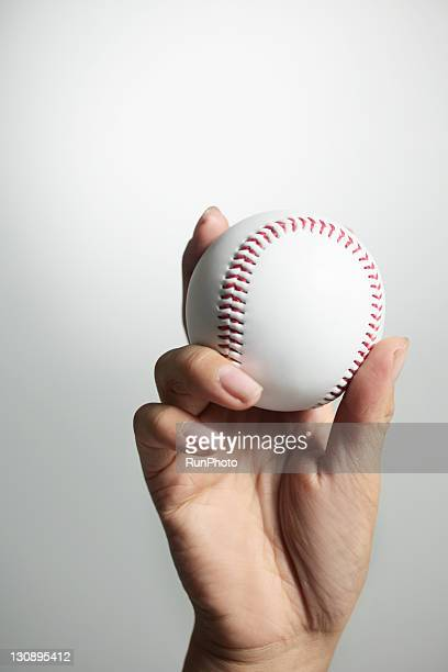 Hand holding a baseball,hands close-up
