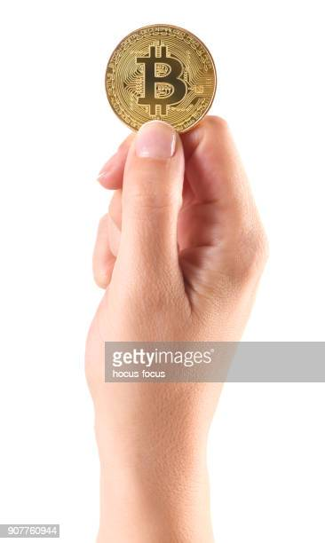 Hand holding a bitcoin