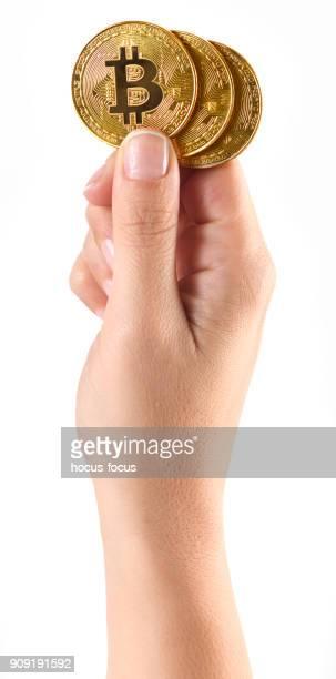 Hand holding a bitcoins