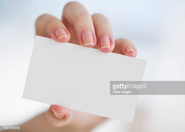 hand holding a blank business card - business cards stock photos and pictures