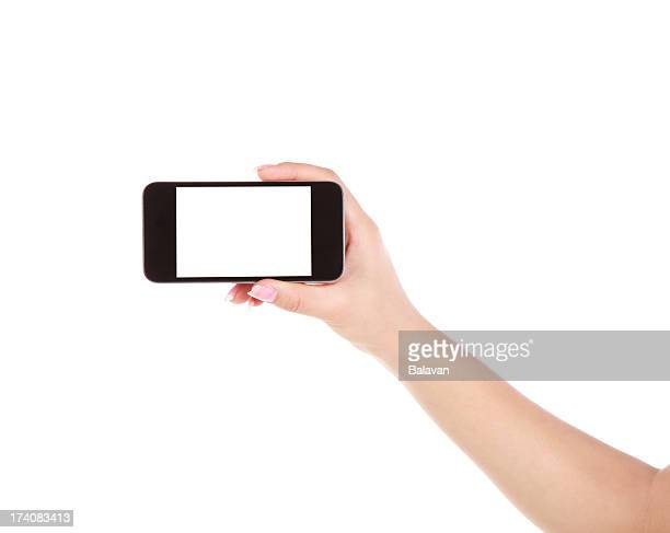 Hand holding a blank mobile phone on a white background