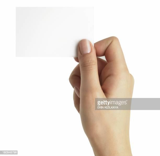 mão com cartão de negócios - braço humano - fotografias e filmes do acervo