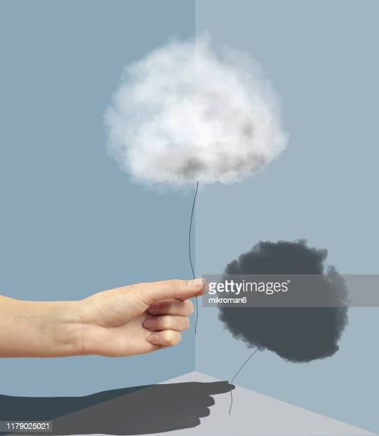 hand holding a cloud with a shadow - hope stock pictures, royalty-free photos & images