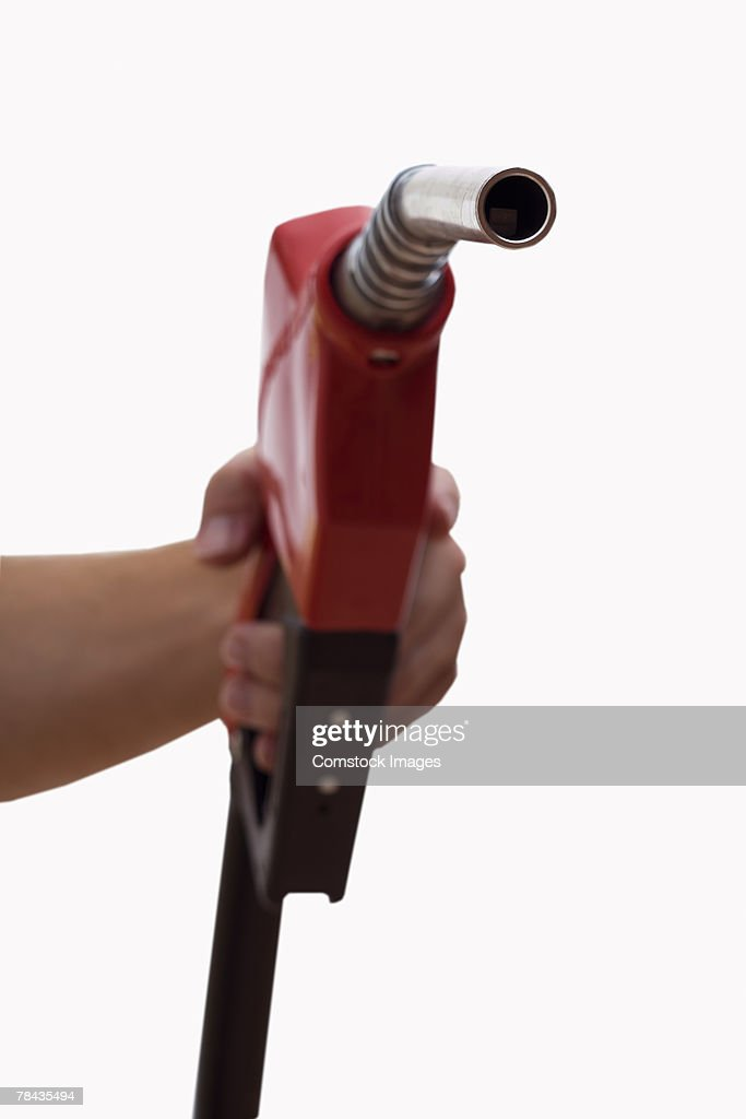 Hand holding a gas pump : Stockfoto