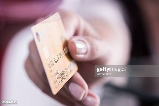 Hand holding a golden credit card