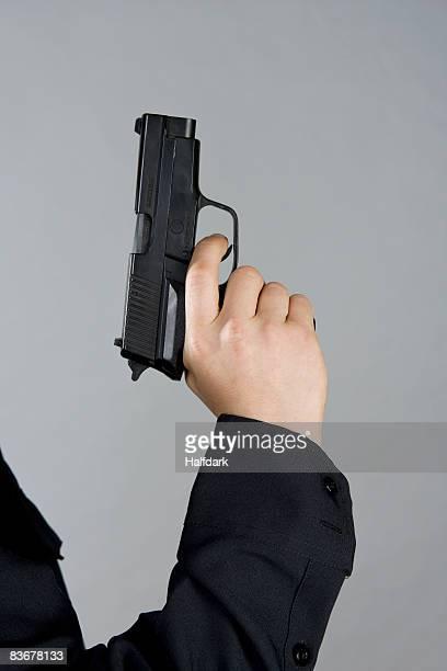 A hand holding a gun
