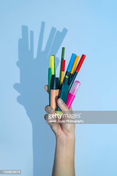hand holding a handful of markers - felt tip pen stock pictures, royalty-free photos & images