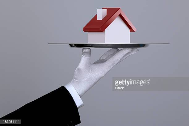 hand holding a house in tray with clipping path - premium access stock pictures, royalty-free photos & images