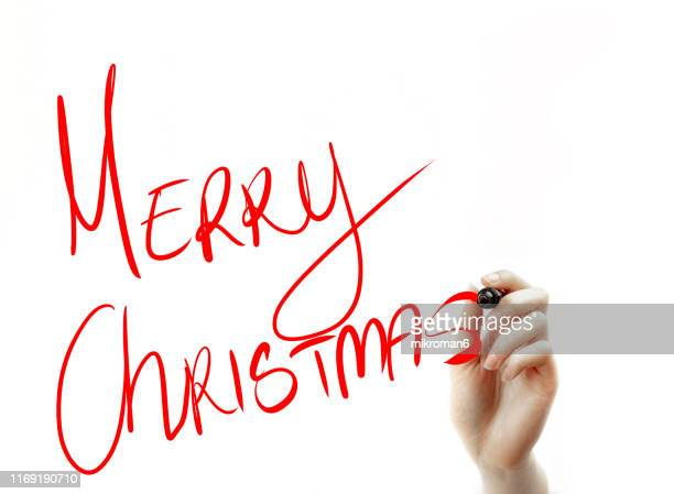 hand holding a marker drawing christmas designs - cartoon santa claus stock photos and pictures