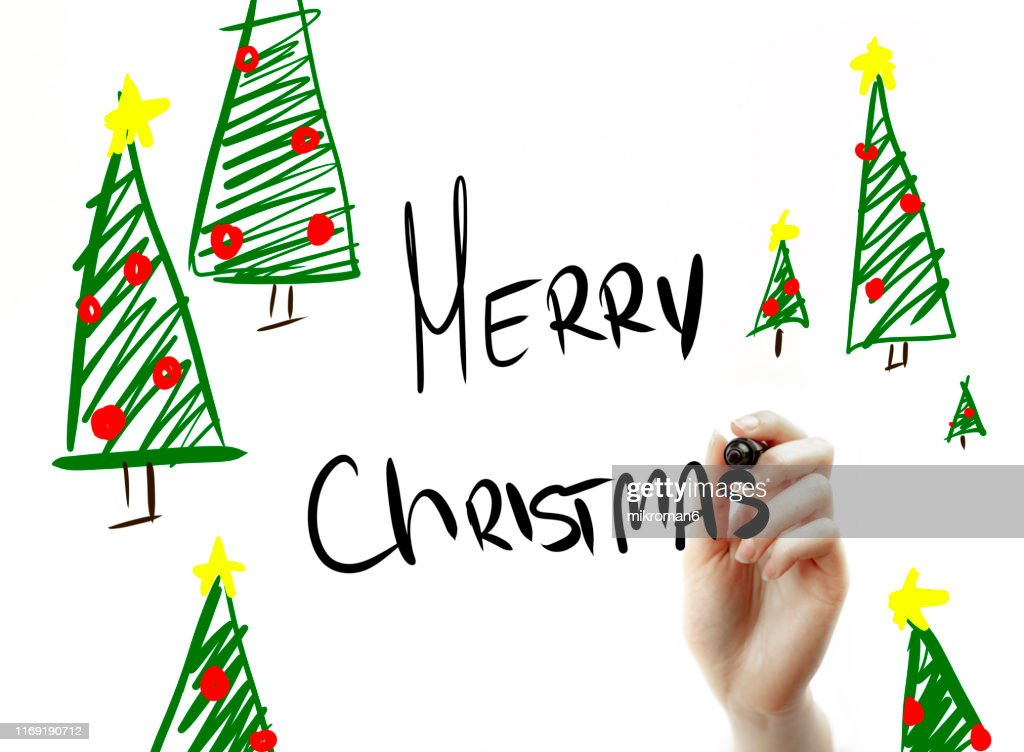 Hand Holding a Marker drawing Christmas designs : Stock Photo