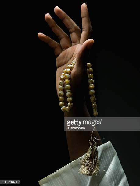 hand holding a muslim rosary - rosary beads stock pictures, royalty-free photos & images