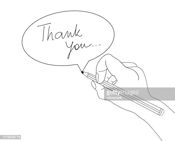 hand holding a pencil drawing a speech bobble with text thank you - thank you stock pictures, royalty-free photos & images