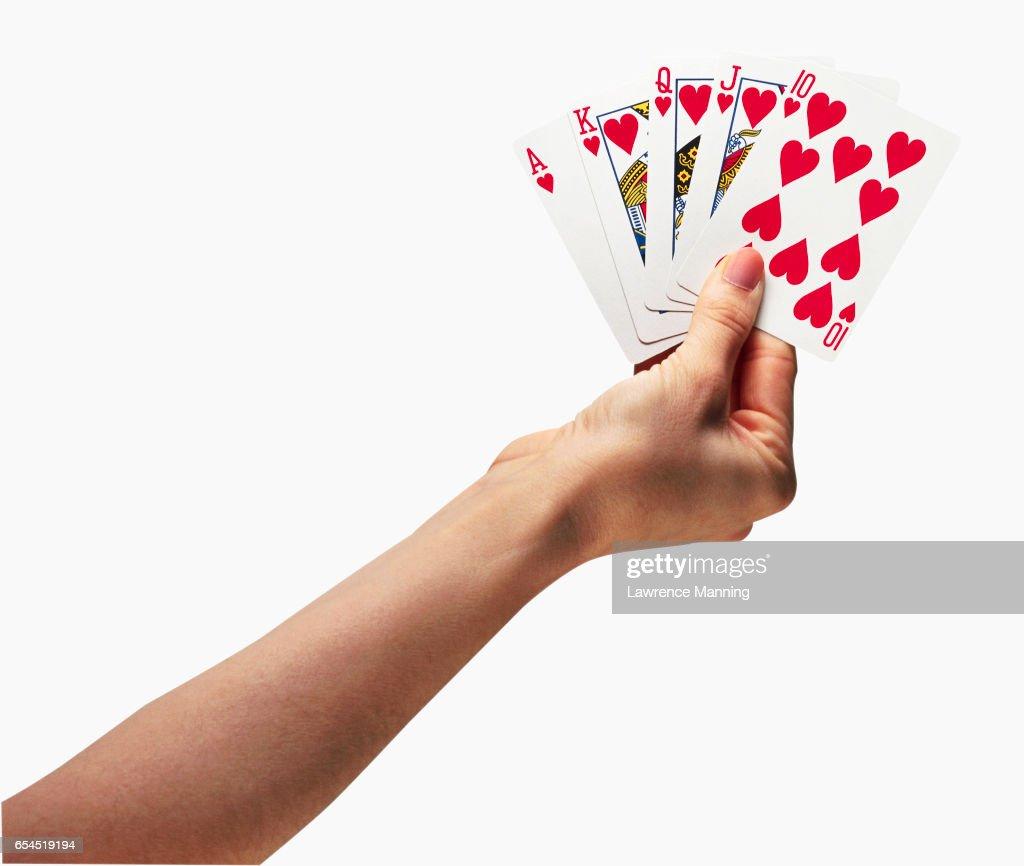 Hand Holding a Royal Flush : Stock-Foto