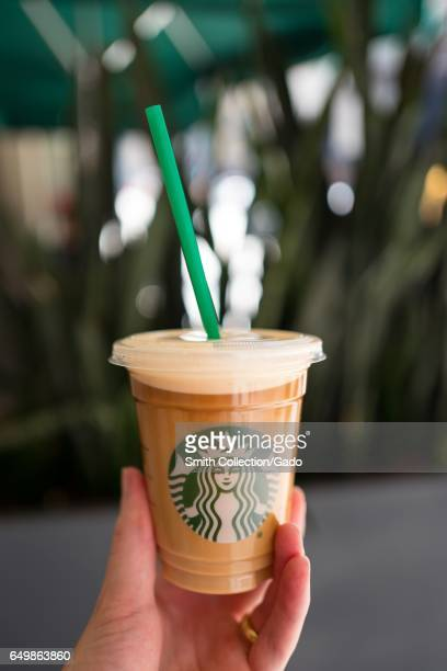 Hand holding a Starbucks Nitro Cold Brew coffee in the Financial District neighborhood of San Francisco California September 26 2016 Nitro Cold Brew...
