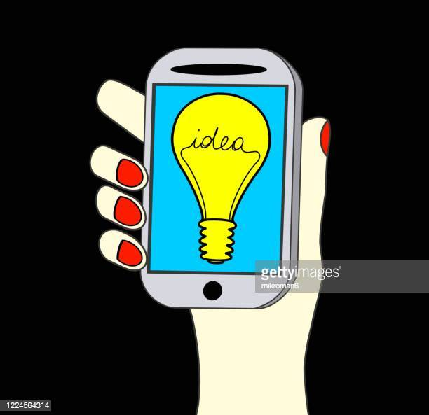 hand holding a telephone with light bulb with the word idea - new business stock pictures, royalty-free photos & images