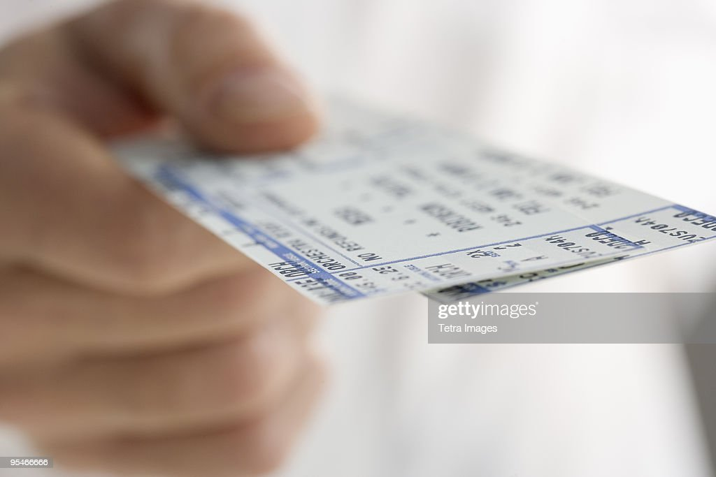 Hand holding a ticket : Foto de stock