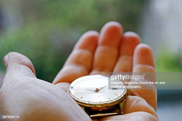 hand holding a watch - gregoria gregoriou crowe fine art and creative photography stock photos and pictures